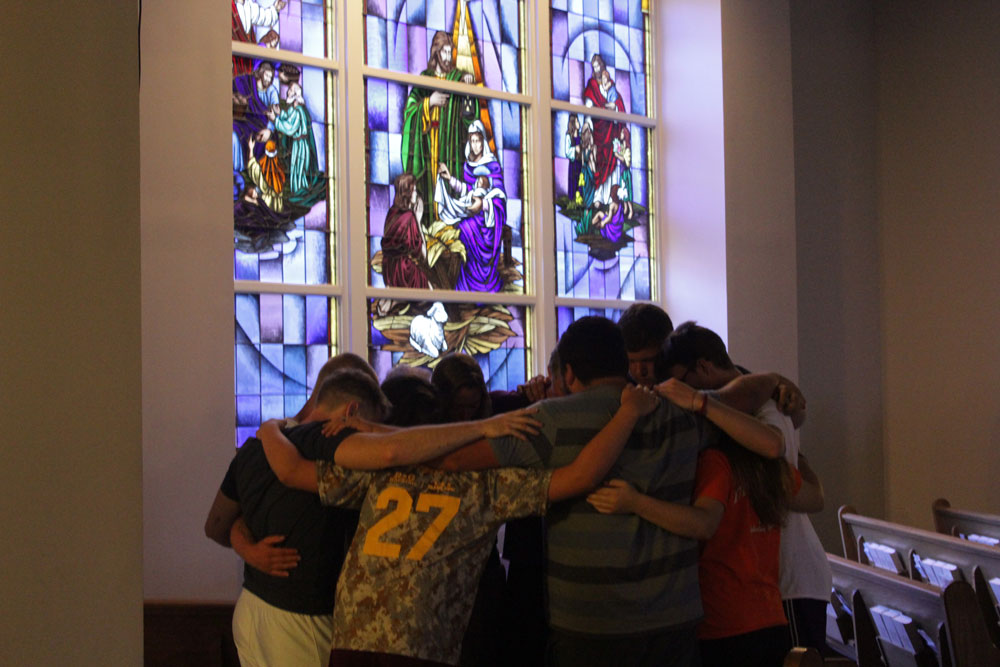 A group of students praying together during our concert of prayer